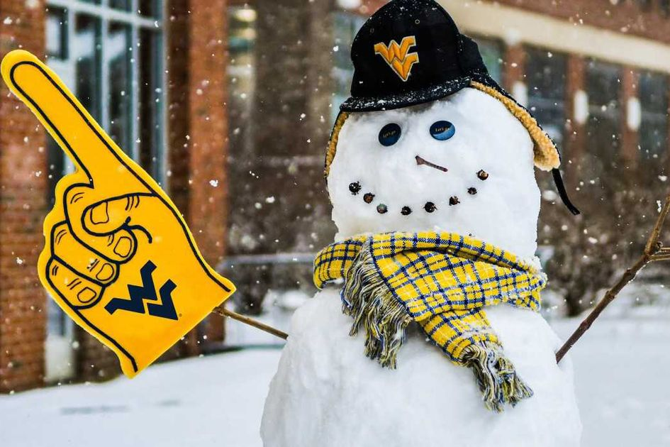 Snowman stands outside with WVU hat, scarf and foam finger.